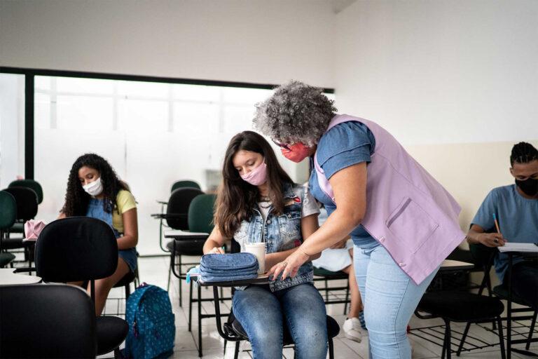 photo - Teacher Helping Student