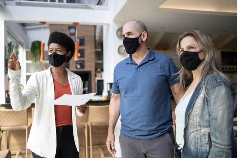 photo - Three Adults Wearing Masks