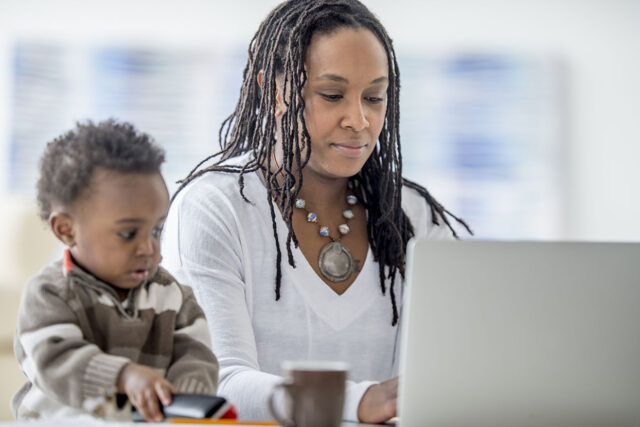 photo - Toddler and Mother on Lap Top