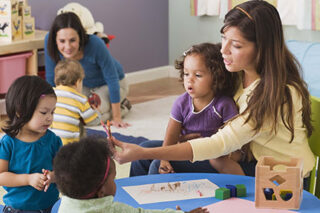 photo - Teachers and Toddlers in Daycare