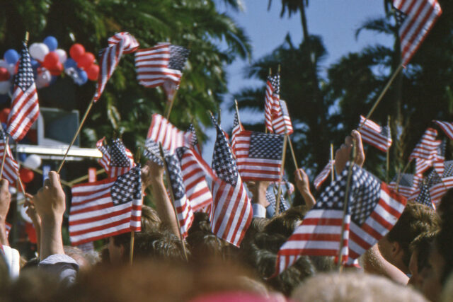 photo - Waving US Flags at a Campaign Rally
