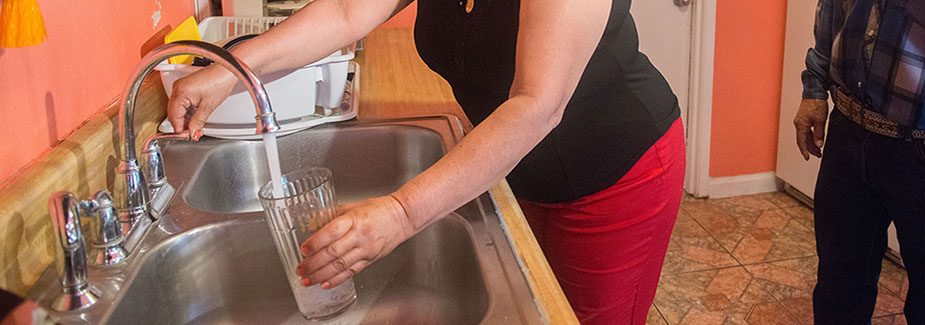 photo - Filling Glass with Water from Kitchen Faucet In East Porterville, California - -pixel-ca-dwr-FL_Porterville-9320
