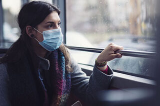 photo - Woman Wearing Mask on Bus