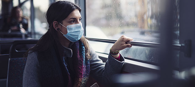 photo - Woman Wearing Mask on Bus