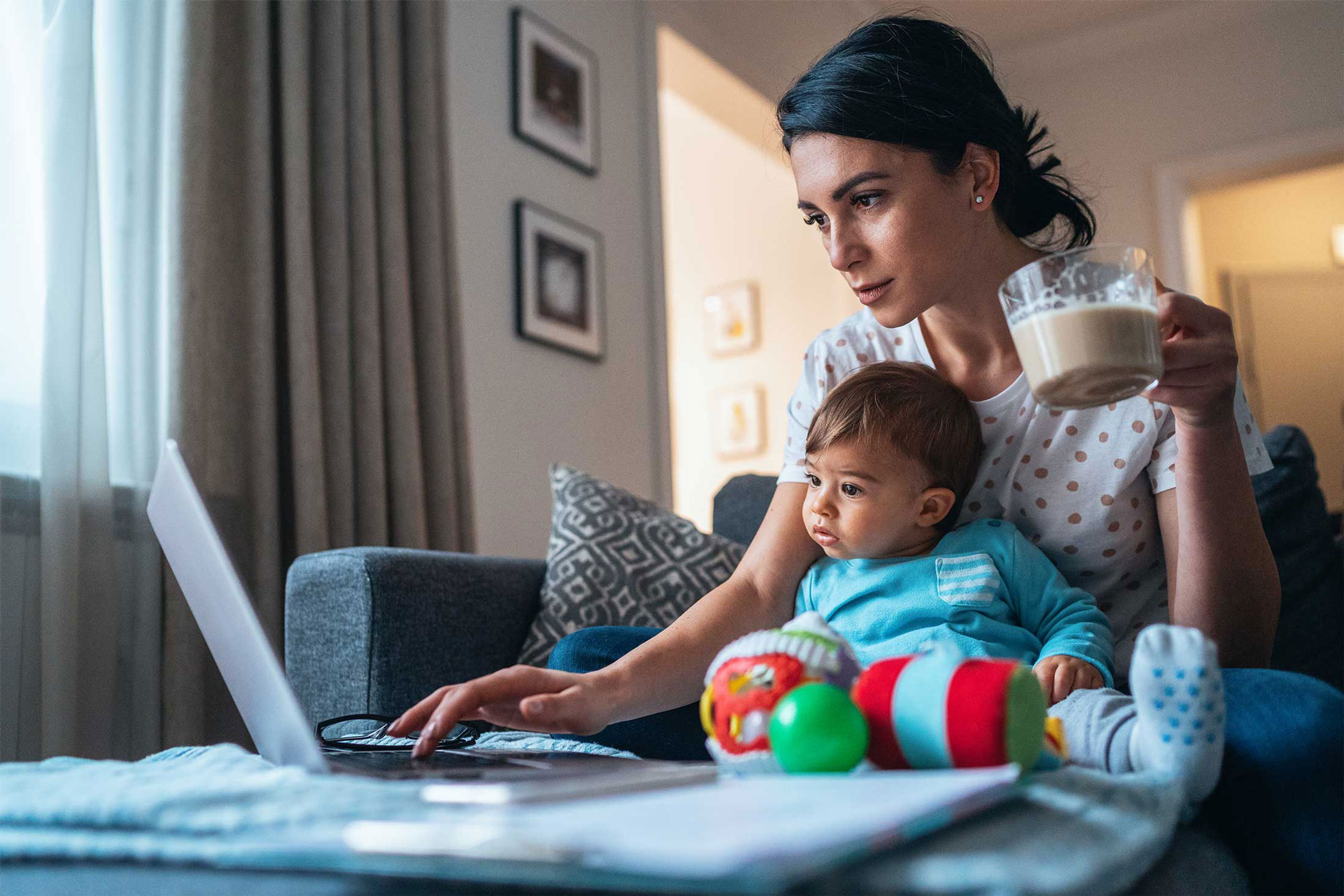 photo - Woman with Baby Working from Home