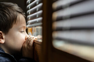 Photo of young boy at the window