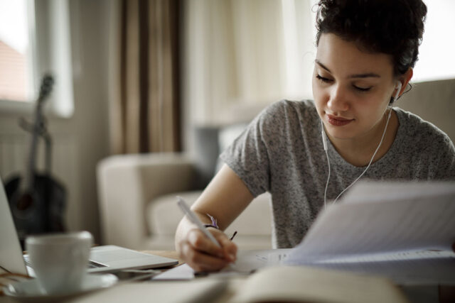 photo - Young Woman Studying at Home