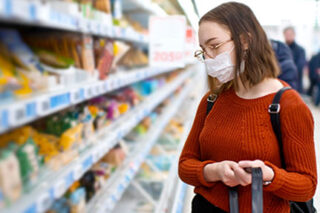 photo - Young Woman Wearing Mask and Grocery Shopping